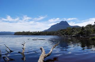 Precipitous Bluff from New River Lagoon. Looking back at Precipitous Bluff as I spend a few hours wading New River Lagoon (there is no track) to finally reach Prion Beach and The South  Coast Track after many days traversing the Southern Ranges.