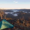 A fair way away from the nearest track. On Snowy Bluff above a valley in the Alpine National Park in Victoria at dawn.