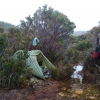 The day after the incident described on the South Coast Track Page. As you can probably make out, the ground was water and bog. I had to set up on tree roots to keep out of the water. I spent that whole clammy uncomfortable remainder of the day and the night in my damp clothes in my wet sleeping bag, on roots and lumps I could feel through my sleeping mat, using my body heat to try and dry everything out. The rain made any other method hopeless.